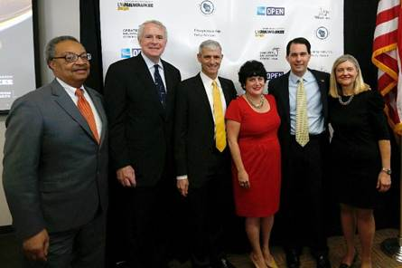 IMAGE DISTRIBUTED FOR AMERICAN EXPRESS OPEN - (left to right) John Daniels Jr., GMC Board Chair, Milwaukee Mayor Tom Barrett, UWM Chancellor Michael R. Lovell, Randi Schochet, VP of American Express OPEN, Govenor Scott Walker and Julia Taylor, President of GMC at the launch of OPEN for Enterprise Press Conference held at The Zilber School of Public Health, University of Wisconsin-Milwaukee on Thursday, March 28, 2013 in Milwaukee, WI. (Scott Boehm/AP Images for American Express OPEN)
